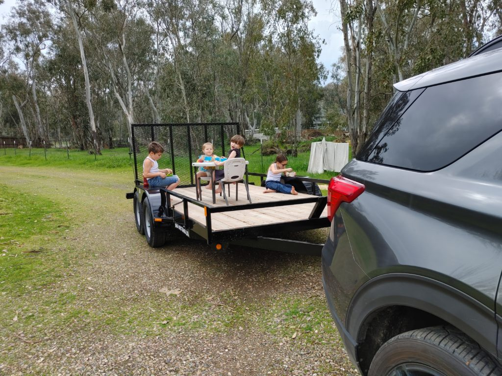 Kids having a tea party on a trailer