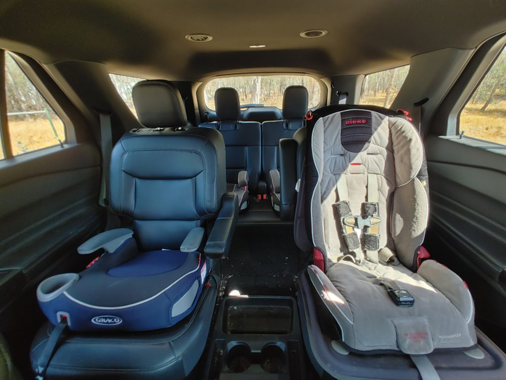 4 car seats in the rear of SUV